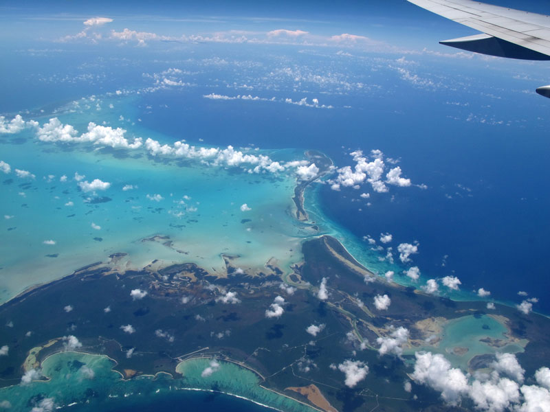 view of caribbean from airplane window aerial barbados Seeing the World Through an Airplane Window