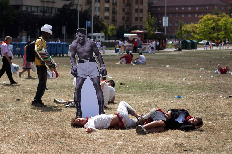 ali cutout placed beside passed out people in park The Shirk Report   Volume 191