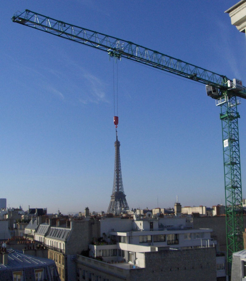 crane in front of eiffel tower perfect timing paris france Picture of the Day: Moving the Eiffel Tower