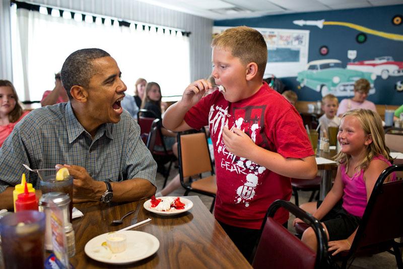 obama kid eating pie