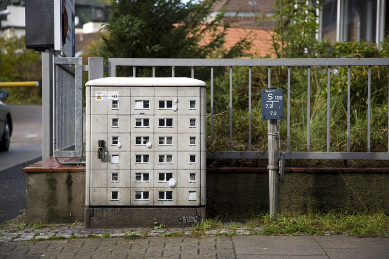 Artist Paints Miniature Apartment Buildings around the City