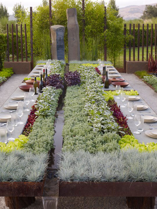 outdoor living garden table with plants and running water (6)