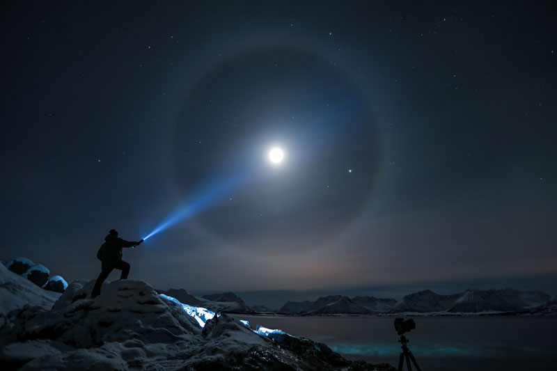 shining flashlight onto moon at night Picture of the Day: Moon Beam