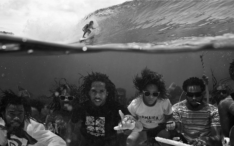 underwater group photo surfing above perfect timing