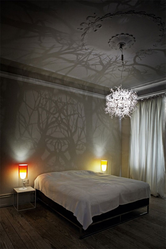 chandelier projects shadow forest on walls hilden and diaz (3)