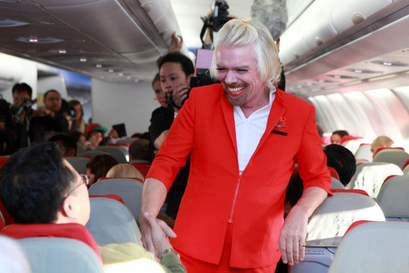 richard branson loses bet dresses as a female stewardess (1)