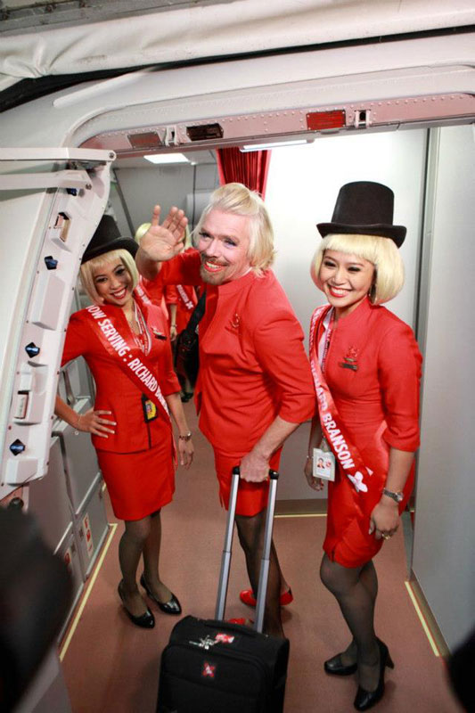 richard branson loses bet dresses as a female stewardess (10)