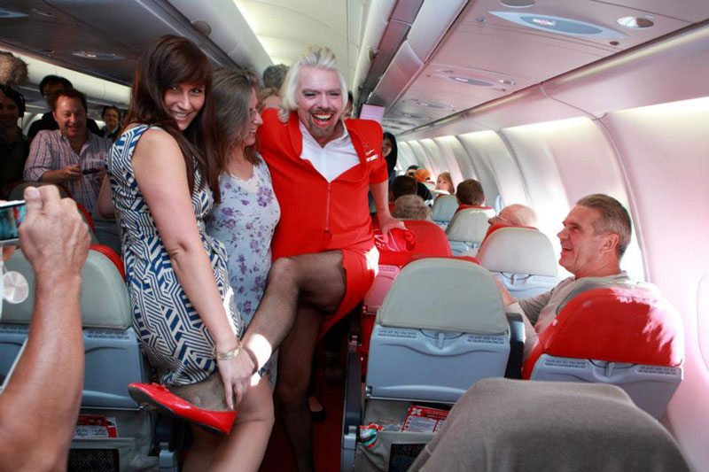 richard branson loses bet dresses as a female stewardess (11)