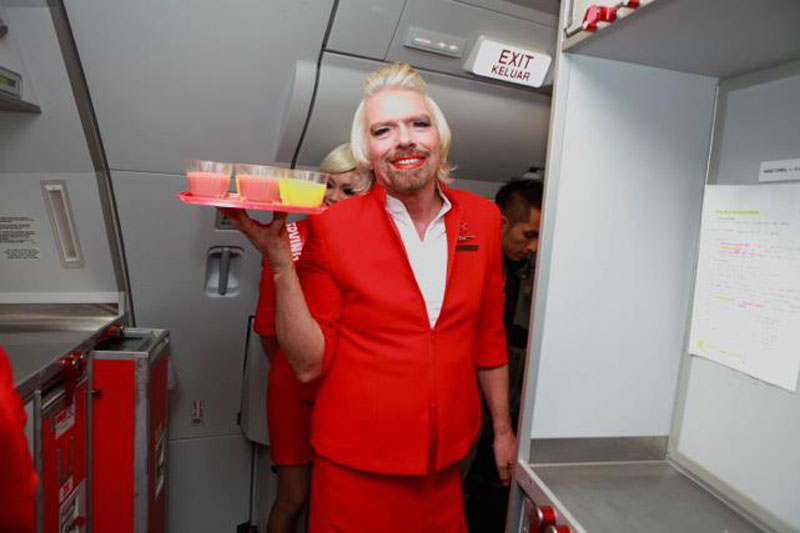 richard branson loses bet dresses as a female stewardess (12)