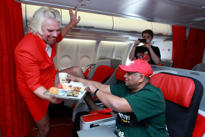 richard branson loses bet dresses as a female stewardess (2)