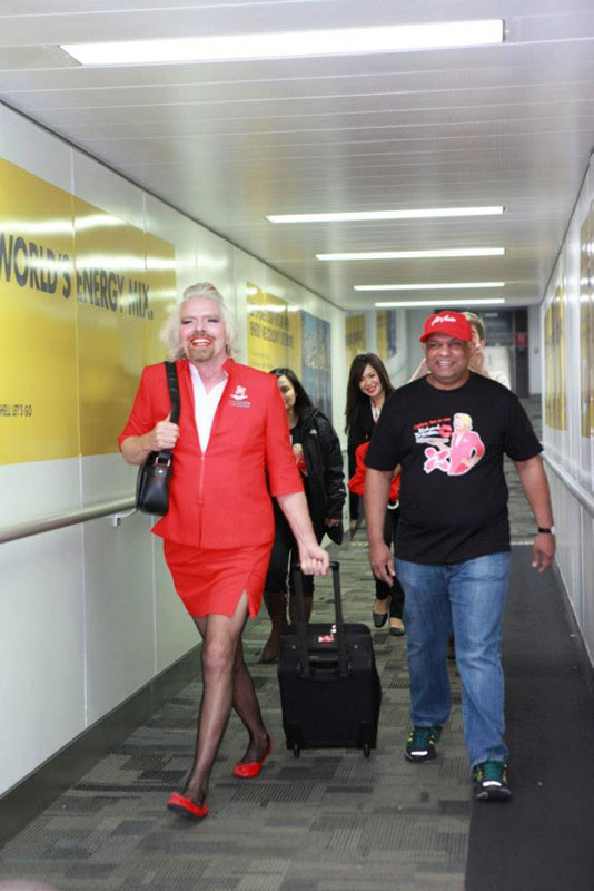richard branson loses bet dresses as a female stewardess (8)