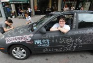 Artist Covers Car in Chalkboard Paint, Lets People Draw On It
