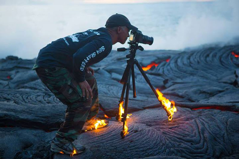 kawika singson standing on lava shoes tripod on fire Picture of the Day: In the Heat of the Moment
