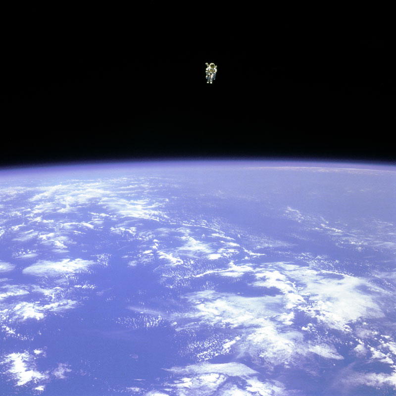 Bruce McCandless II free flying in space floating untethered