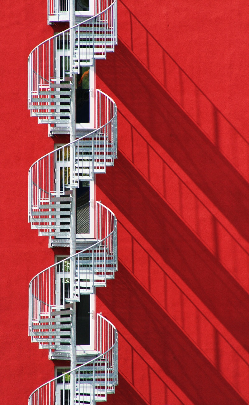 spiral staircase and shadows red white
