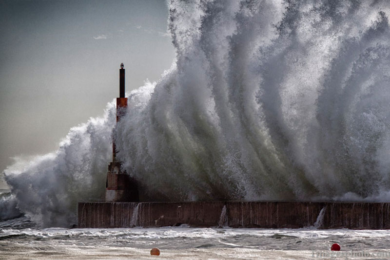crashing waves into lighthouse pier gaia portugal The Top 100 Pictures of the Day for 2013