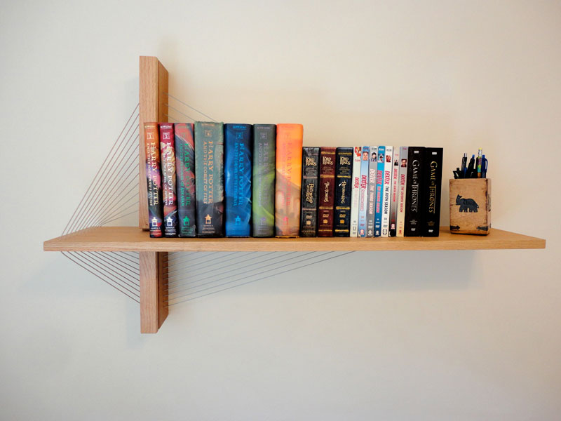 furniture held together just by tension robby cuthbert 1 Floating Bookshelves Held Up By a Magnetic Superhero