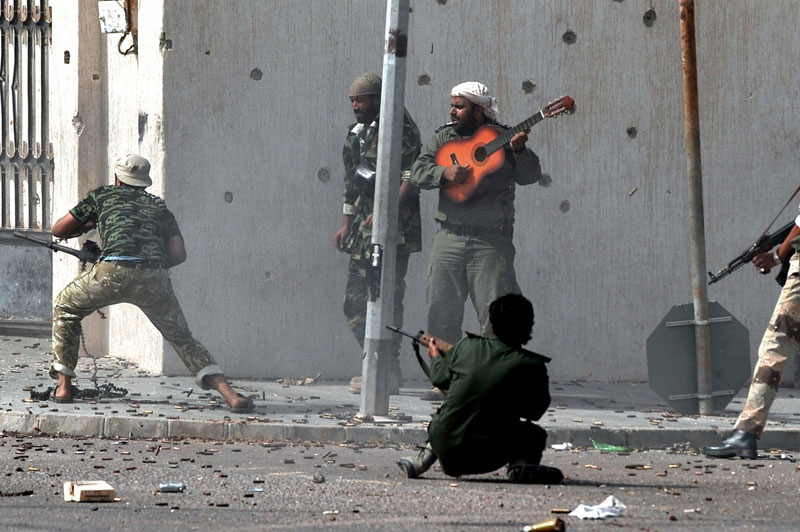 libyan civil war revolution guitar player 2011 bard qatar hero 6 Powerful Images of Music in Unexpected Places