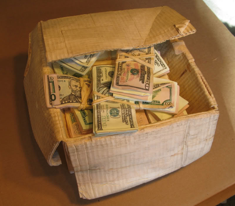 randall rosenthal carves a block of wood into a box of money (13)
