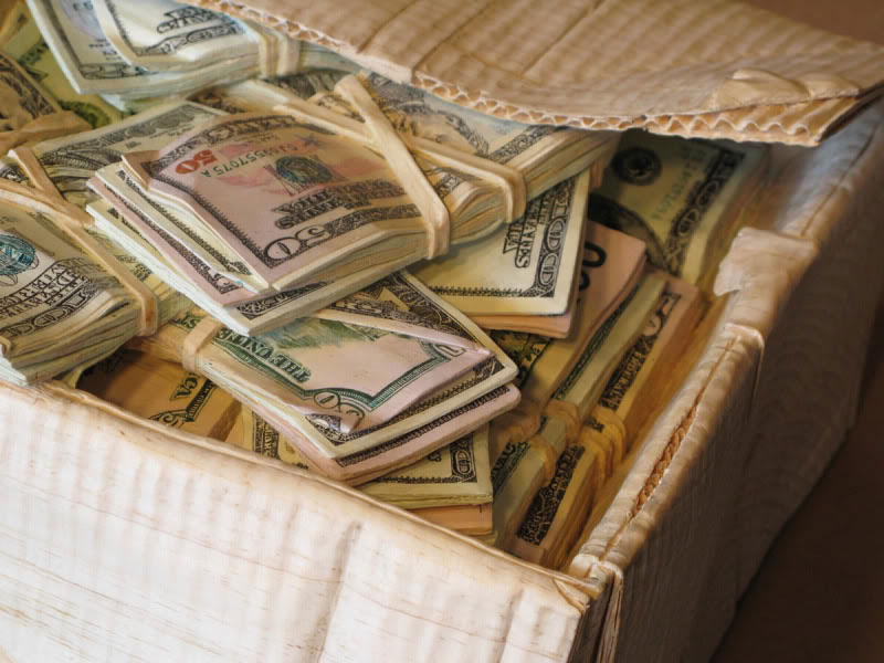 randall rosenthal carves a block of wood into a box of money (16)