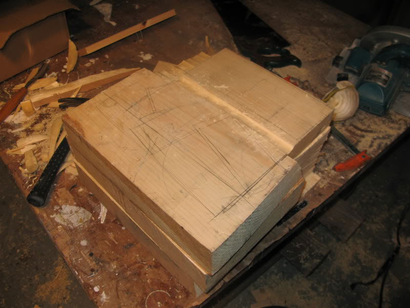 randall rosenthal carves a block of wood into a box of money (3)