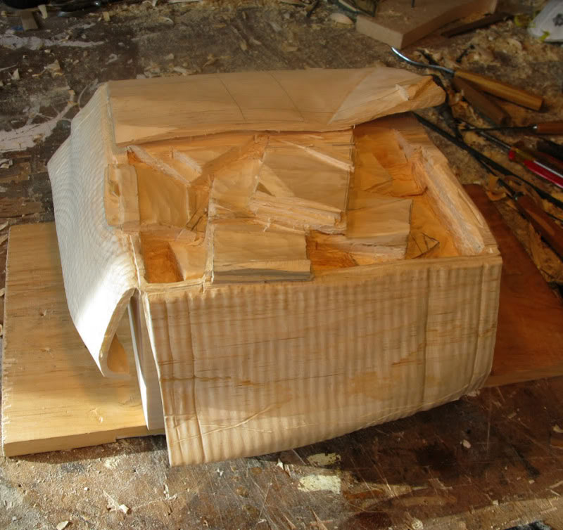 randall rosenthal carves a block of wood into a box of money (7)