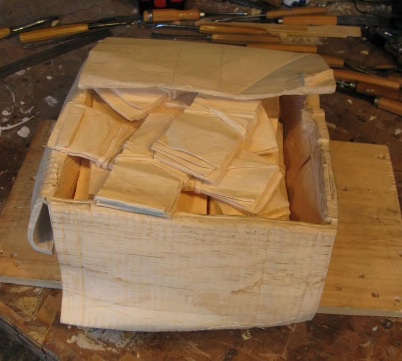 randall rosenthal carves a block of wood into a box of money (8)
