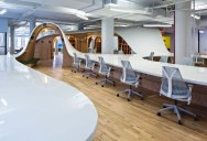 This 1,100 ft long Office Desk Seats All 125 Employees