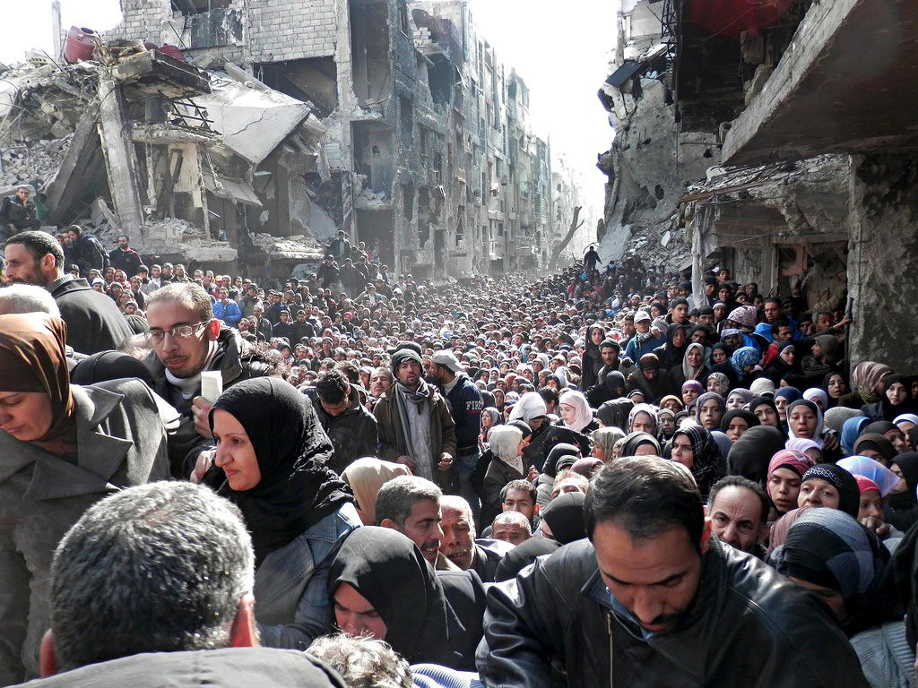 waiting for food at refugee camp in yarmouk damascus syria Picture of the Day: Waiting for Relief