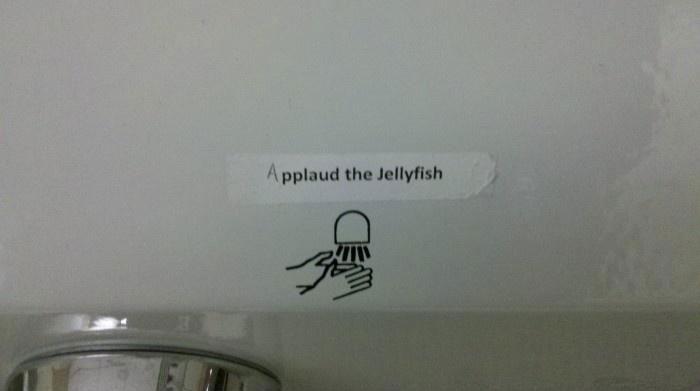 applaud the jellyfish sign