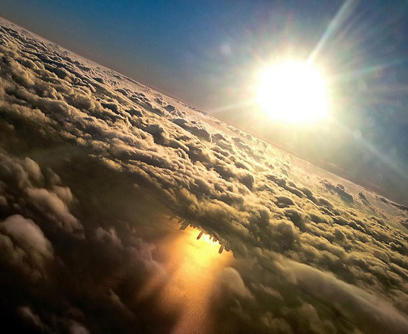 chicago reflected in lake michigan from an airplane by mark hersch Earth View: A Curated Collection of 1500 Google Earth Wallpapers