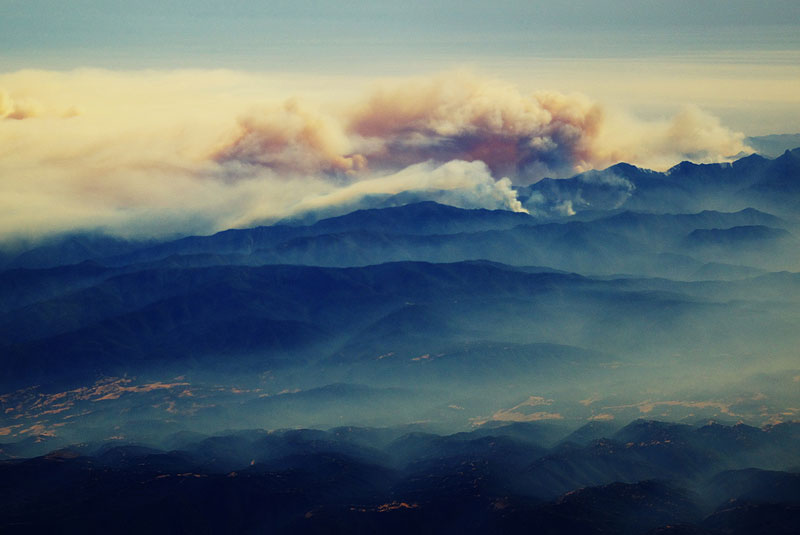 forest fire from an airplane big sur california 27 Reasons Why You Should ALWAYS Ask for the Window Seat