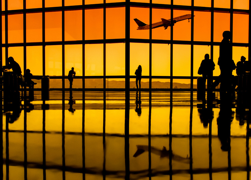 watching planes takeoff through terminal windows yellow orange tint Picture of the Day: I Want to Fly Away