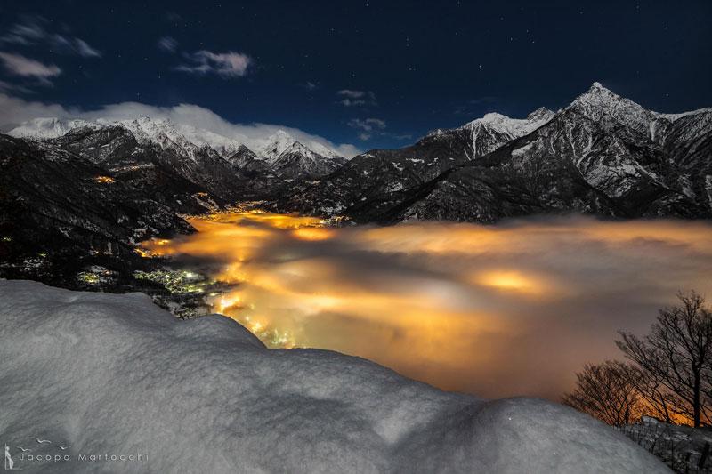 CHIAVENNA italy fog illuminated at night