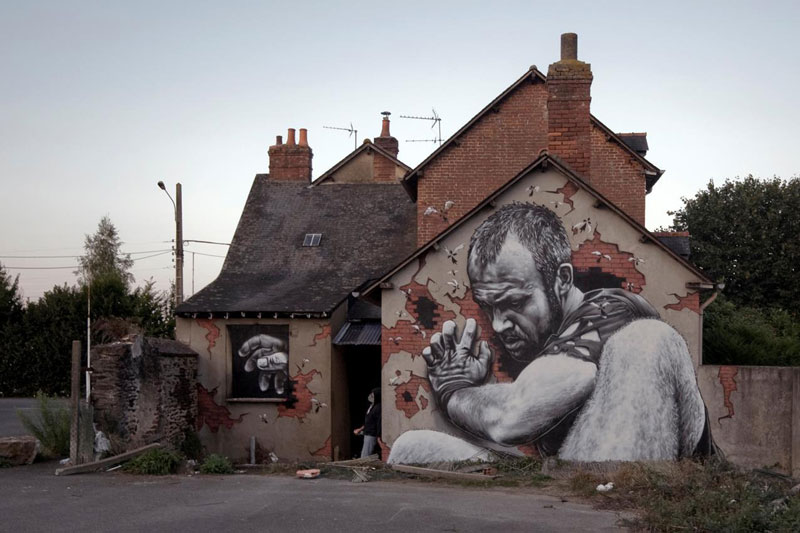 street art graffiti by mto 2 MTO Completes 2 Part Mural in Two Countries to Highlight Immigration Issues