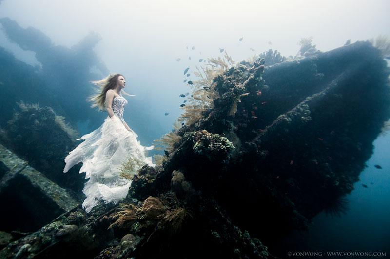 underwater photoshoot with freedivers and a shipwreck in bali by benjamin von wong 4 Husky Walks on Water After Heavy Rainfall Covers This Frozen Lake (10 Photos)