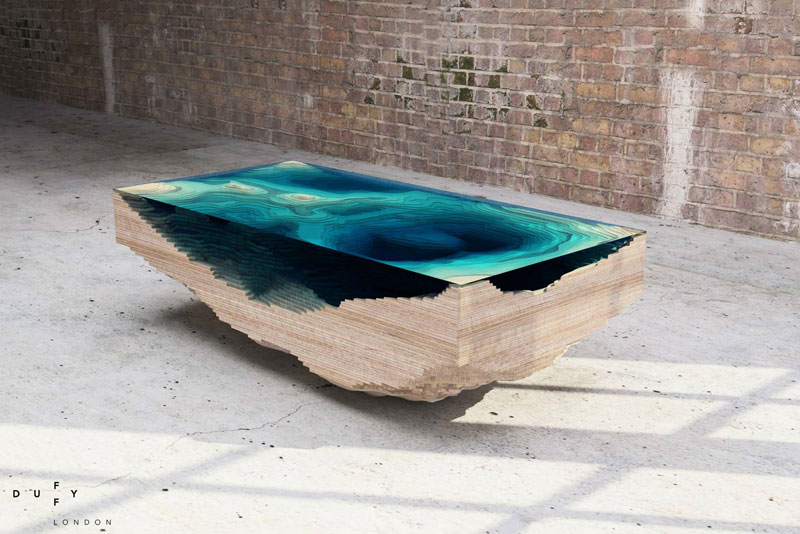 layered glass coffee table shows depths of the oceans by duffy london 2 Molten Metal Meets Wood to Create One of a Kind Furniture