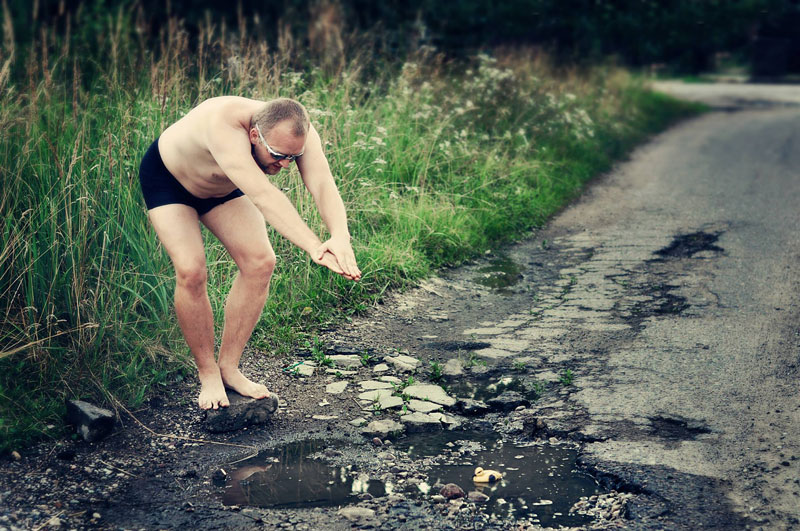 lithuanian artists create funny photos to highlight their citys pothole problem (5)