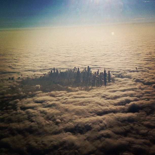 chicago from airplane cloud city covered
