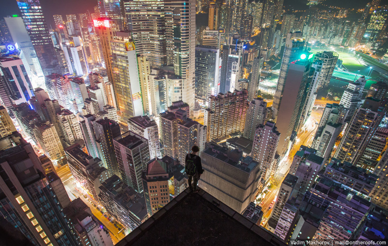 hong kong at night from above rooftopping aerial on the roofs vadim makhorov Picture of the Day: Hong Kong Rooftopping at Night