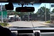 Amateur Footage Shows Train Crashing Into 18-Wheeler Stuck on Tracks