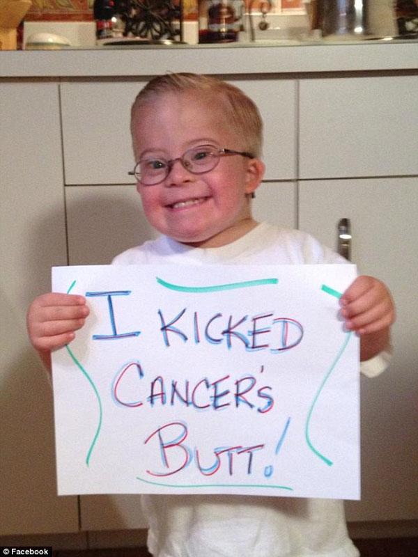 boy with down syndrome leukemia liam fitzgerald fist bumps boston bruins (2)