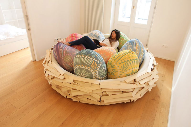 giant birds nest by oge creative group 3 Floating Bookshelves Held Up By a Magnetic Superhero