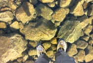 Walking on a Frozen Lake with Extremely Clear Water
