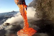 Extremely Close-Up Footage of Lava Spilling Into Water