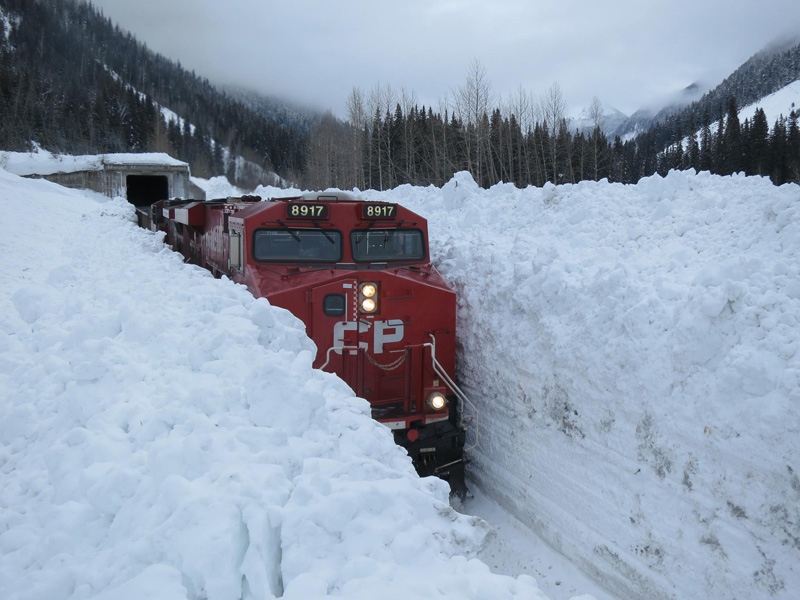 train going through huge snow wall in canada The Top 100 Pictures of the Day for 2015