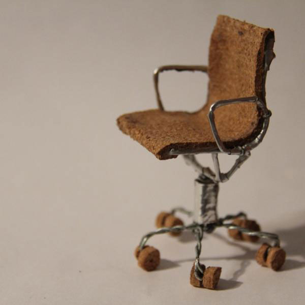 Tak-Eames-Aluminum-Group-Mgmt-Chair-with-cork-casters---frame-wrapped-in-Billecart-Salmon-foil,-polished-base-wrapped-in-Veuve-Clicquot-foil,-cork-seating-(front-view-of-chair,-left-angle)