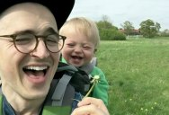 Baby Can't Stop Laughing at his Dad Blowing on Dandelions