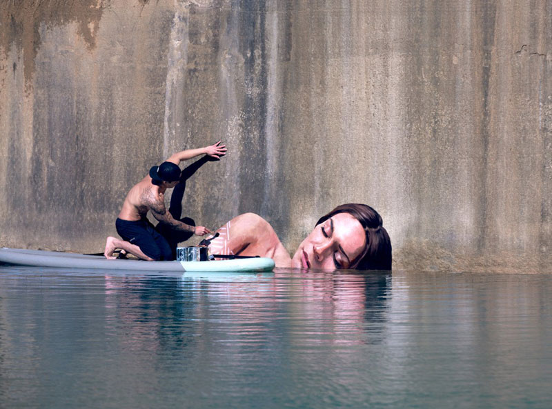 Street Artist HULA Uses Paddleboard to Paint in Hard to Reach Places