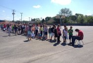 Students Lining Up to Get Their Yearbook Signed by Mr Steve the Custodian